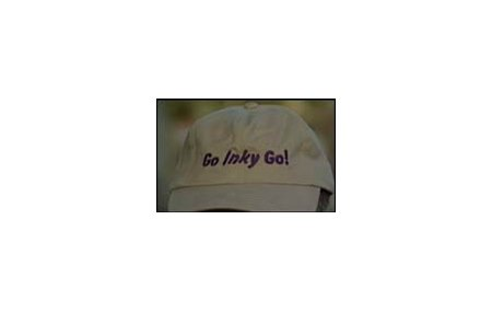 Cap with slogan that includes Invisible Ink's nickname.
