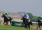 Reliable Man (blue & white silks) rolls in the French Derby.