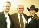 New Mexico state representative Candy Spence Ezzell (right), Dr. Leonard Blach (center), and Scott Scanland of Sunland Park celebrate Mine That Bird as New Mexico Horse of the Year for 2009.