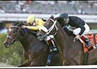 Hard Buck, under Edgar Prado in yellow silks, defeats Balto Star in the Gulfstream Breeders' Cup Handicap.