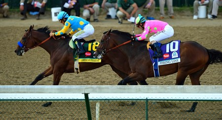 American Pharoah charges towards the finish line in the 141st running of the Kentucky Derby.