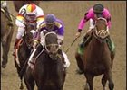 Longshot Fifty Stars leads Millennium Wind (left) and Dollar Bill (right) to the finish line in his Louisiana Derby victory.