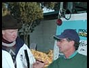 David Rollinson (left), representing Pimlico, accepts a nomination to the Visa Triple Crown from trainer David LaCroix at Hollywood Park.