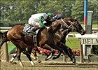 Beacon Shine noses out a win in the Flash Stakes, Friday at Belmont Park.
