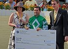 Kent Desormeaux with the Jockey Challenge winning check.