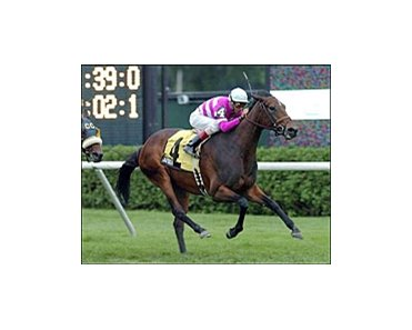 Arvada, ridden by John Velazquez, captures the Glens Falls Stakes at Saratoga.