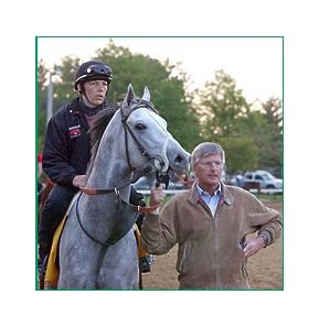 Trainer Michael Dickinson (right) with Tapit.