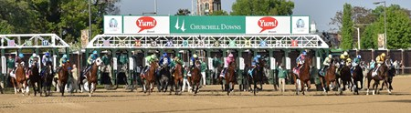 Horses break for position out of the starting gate.