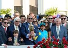 Ahmed Zayat (center with trophy) after his Kentucky Derby win.