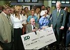Roy and Pat Chapman, center, hold enlarged copy of a $5 million bonus check given them by Oaklawn Park owner Charles Cella, far right, while trainer John Servis and his wife, Sherry, far left, look on.