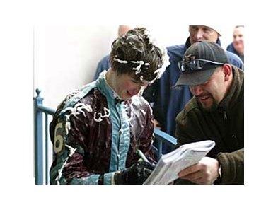 Joe Musarro signs an autograph Feb. 22 at Turfway Park after his first-ever win as a jockey.