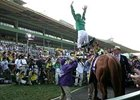 Frankie Dettori's trademark flying dismount after winning the Breeders' Cup Classic aboard Raven's Pass