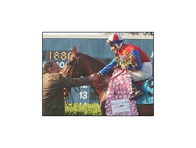 Trainer Bobby Frankel congratulates jockey Edgar Prado after Peace Rules' win in the Louisiana Derby.