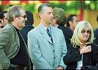 Trainer Todd Pletcher is flanked by Stuart and Anne Subotnick.