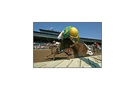 Matt Goins' Eclipse Award-winning photo shows jockey Julien Leparoux hanging over the head of his mount during a race at Keeneland.