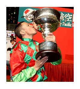 Frankie Dettori celebrates winning the Hong Kong Jockey's Challenge.