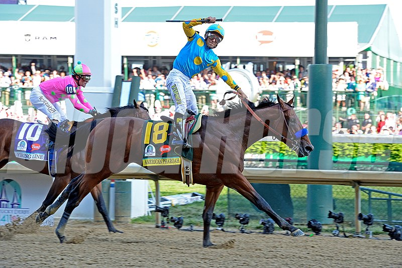 American Pharaoh and jockey Victor Espinoza cross the finish line in the 2015 Grade I Kentucky Derby at Churchill Downs in front of a record crowd of 170,513.