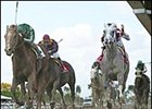 Friends Lake, left, leads Value Plus, second from right, to victory in the Florida Derby.