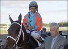 Owner Paul Saylor leads Fleet Indian to the winner's circle after her early October victory in the Beldame Stakes.