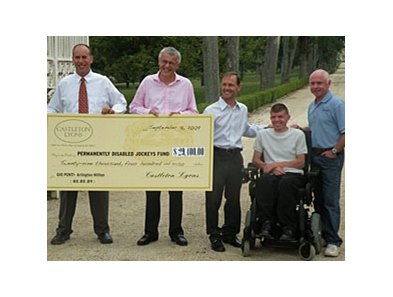 Castleton Lyons presents a check for $29,400 to the Permanently Disabled Jockeys Fund.