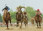 "The trifecta in the 2007 Preakness was the same as the Derby, but in a different order.<br><a target=""blank"" href=""http://photos.bloodhorse.com/TripleCrown/Older-Triple-Crown-Images/Past-Preakness-Stakes-Winners/i-2CB6zQc"">Order This Photo</a>"