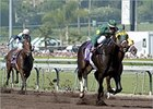 Cajun Beat, center, finishes first in a blistering Sprint.