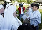 Smarty Jones' trainer John Servis, right, points skyward while making a joke with the Little Sisters of the Poor nuns.