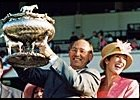 Sarava's owner Gary Drake, holding Belmont trophy, with wife, Kitty.