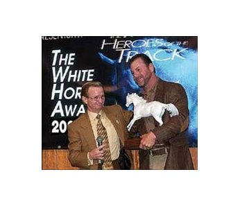 Louis Pomes (right), with presenter <br>Pat Day, receives the White Horse Award from the Racetrack <br>Chaplaincy of America.