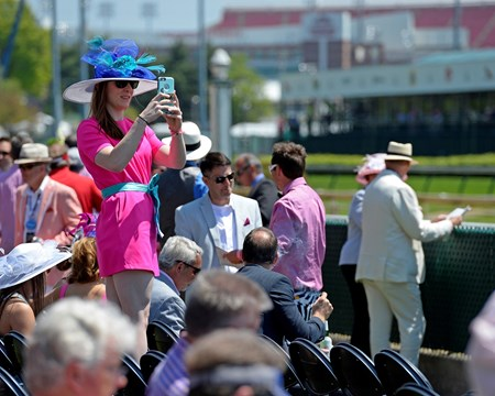 Caption:  fans, fashion, and social media in new owners area by tunnel/track