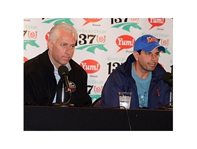 Todd Pletcher (left) and Mike Repole explain the scratch of Uncle Mo.