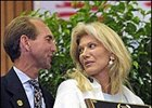 Madeleine Paulson, right, and jockey Jerry Bailey after Cigar was inducted into racing's Hall of Fame in August 2002.