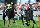 "Ironicus flies home to win the Longines Dixie.<br><a target=""blank"" href=""http://photos.bloodhorse.com/AtTheRaces-1/At-the-Races-2015/i-3dQjmmd"">Order This Photo</a>"