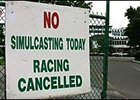 Sign at Monmouth Park informs patrons that the track is closed for live and simulcast racing.