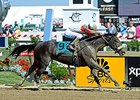 "Irish Jasper comes home strong to win the Adena Springs Miss Preakness Stakes.<br><a target=""blank"" href=""http://photos.bloodhorse.com/AtTheRaces-1/At-the-Races-2015/i-6SVPbZP"">Order This Photo</a>"