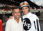 John Velazquez (right) is congratulated by Angel Cordero Jr, after moving  into the No. 2 spot among the all-time leading jockeys at Saratoga Race Course.