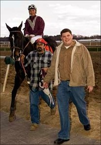 Trainer Cleve Delp (right) saddles first winner of his career, Friday at Laurel Park.