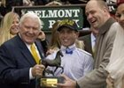 Merv Griffin (left) celebrates Stevie Wonderboy's BC Juvenile win with jockey Garrett Gomez and trainer Doug O'Neill.