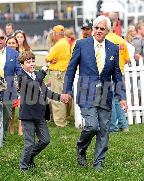 Trainer Bob Baffert and his son Bode walking into the paddock before the Preakness Stakes.
