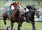 Buzzards Bay, left, beats General John B to win the Santa Anita Derby.