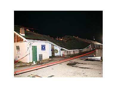 A tornado damages barns at Churchill Downs.