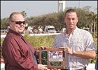 "Bob Umphrey, left, who died Monday,  makes the Calder ""Barn of the Month"" presentation to trainer Barry Croft on Saturday, Dec. 31, 2005."