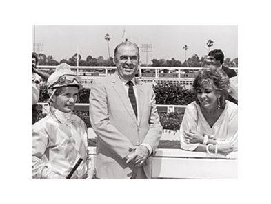 Elizabeth Taylor at Hollywood Park with trainer Laz Barrera and Jockey Bill Shoemaker.