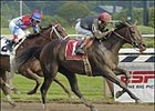 Storm Flag Flying, right, with John Velazquez up, captures the Personal Ensign Handicap at Saratoga Race Course; Azeri was second.