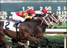 Round Pond (inside) survives a tough duel with Happy Ticket (2) to win the Azeri BC, Saturday at Oaklawn Park.