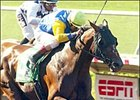 Pleasantly Perfect, ridden by jockey Jerry Bailey, draws away to win the Pacific Classic, Sunday at Del Mar.