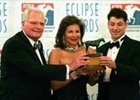 William, Suzanne, and Andrew Warren hold the Eclipse Award for Champion Older Male and Horse of the Year Saint Liam.