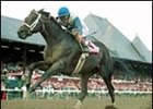 Scorpion, shown winning the Jim Dandy, is highweighted at 121 pounds for the seven-furlong Malibu Stakes.