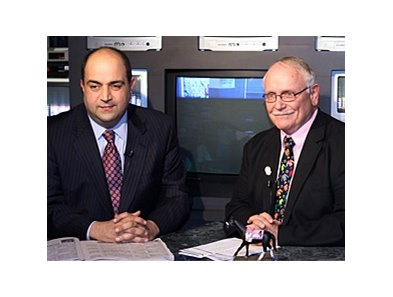 Terry Wallace (right) with Frank Mirahmadi in Oaklawn Park announcer's booth.