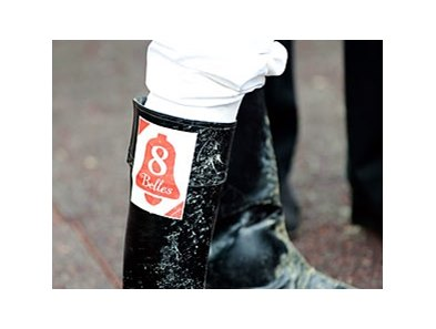 In memory of Eight Belles, Chris Emigh wears a patch on his boots. Emigh won the Miss Preakness Stakes aboard Palanka City on May 16.
